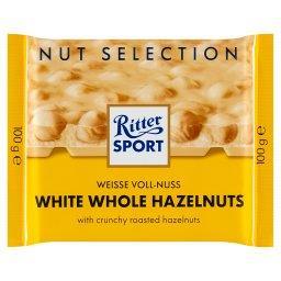 Biała czekolada z całymi prażonymi orzechami laskowy...